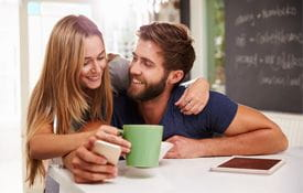 couple drinking coffee in coffee house