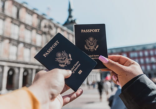 couple-holding-up-their-us-passports-in-madrid-spain.jpg