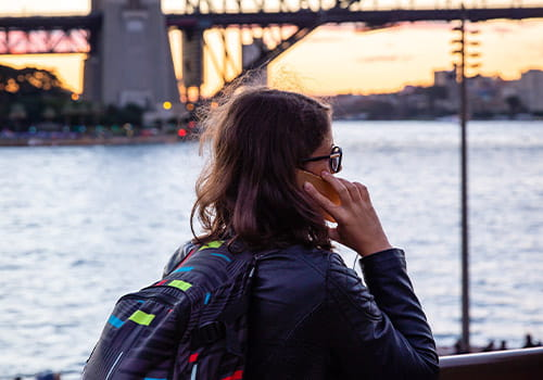 female-study-abroad-student-talking-on-a-cell-phone-in-sydney-harbour-australia.jpg