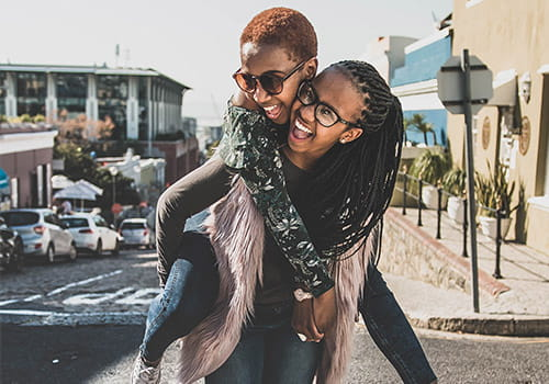 study-abroad-student-giving-her-friend-a-piggyback-ride-in-cape-town-south-africa.jpg