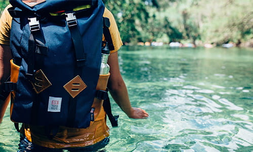 backpacker-wading-through-a-river-with-his-pack.jpg
