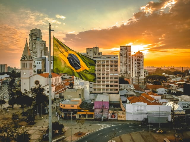 brazil flag in front of city background