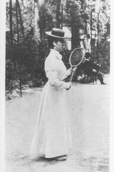 One of the first female Olympians with tennis racquet