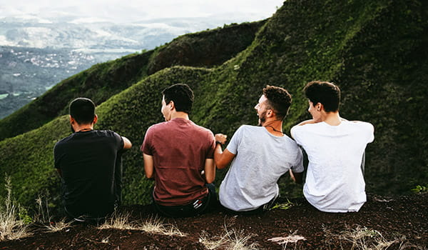 group-of-college-age-missionaries-sitting-on-a-cliff.jpg