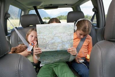 three little girls on road trip in the car