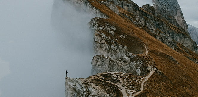 image of a person standing on top of a mountain