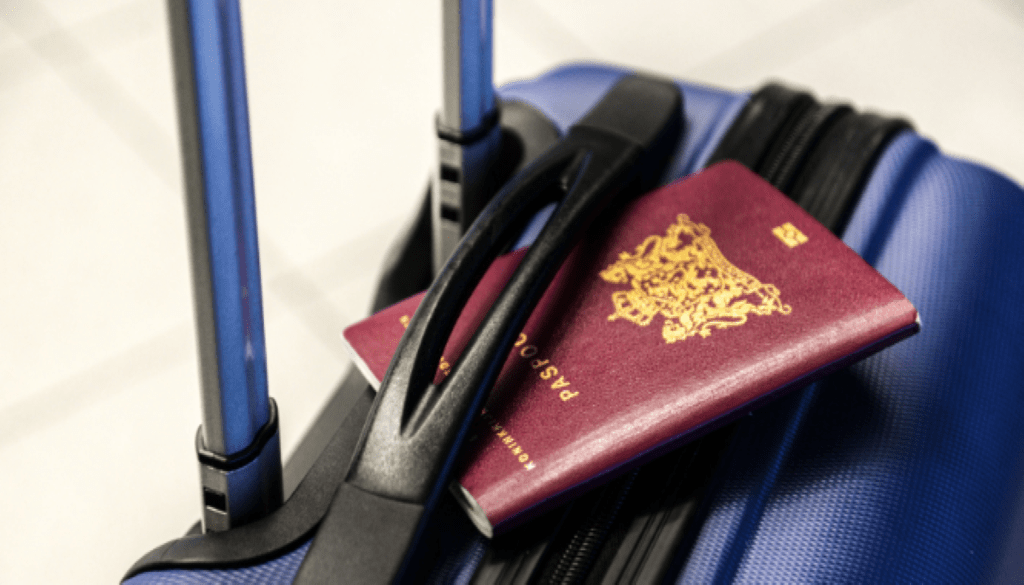 traveling suitcase with passport