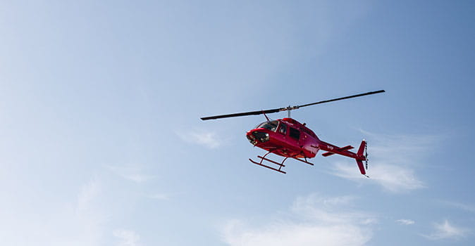 emergency medical evacuation helicopter flying in the sky